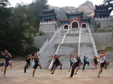 The students practising shaolin kung fu in the Daoism Temple near academy.