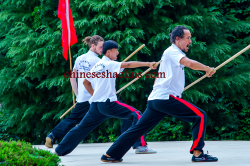 performing shaolin staff by students